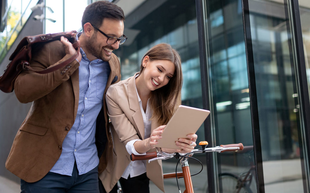 couple happy looking at paperwork in street