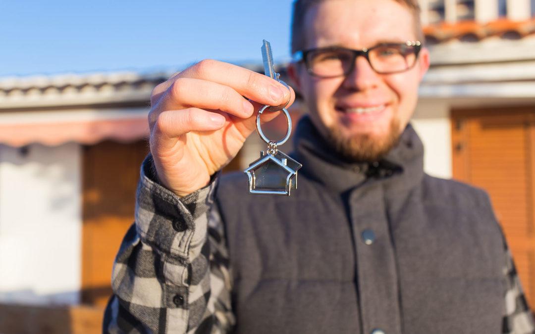 Man Holding a house key