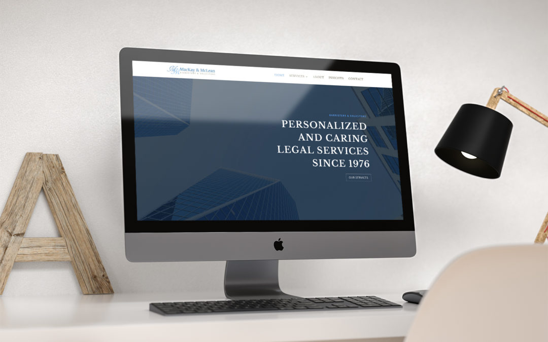 Image of Mackay & McLean website on an iMac